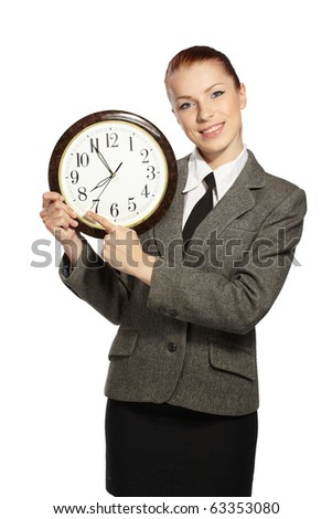 Businesswoman holding clock in hands