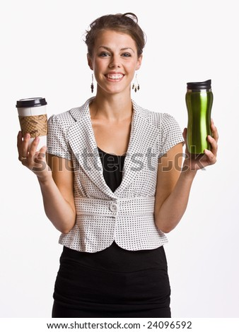 Businesswoman holding coffee cups - stock photo
