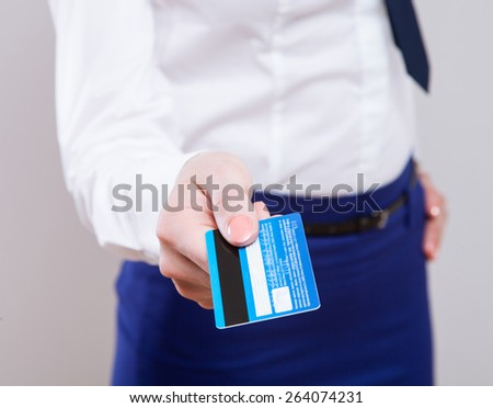 Businesswoman holding credit card - closeup shot - stock photo