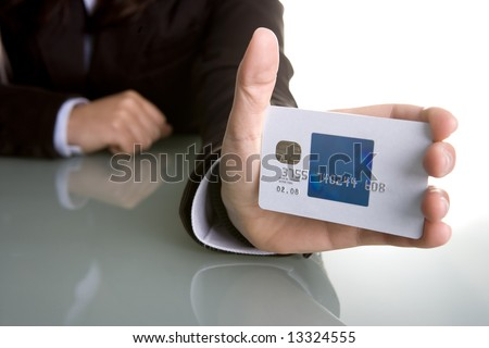 businesswoman holding credit card in the hand - stock photo