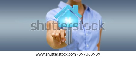 Businesswoman holding digital key flying over his hand - stock photo