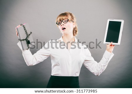 Businesswoman holding document and tablet. Choice between digital and physical data storage. Woman with padlock chained file and pc computer. - stock photo