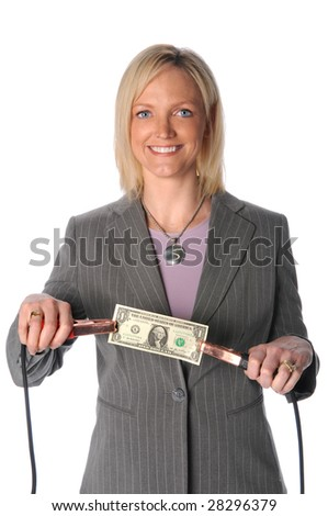 Businesswoman holding dollar bill with jumper cables
