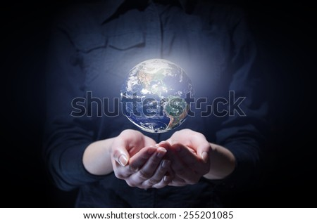 Businesswoman holding Earth planet in palm. Elements of this image are furnished by NASA - stock photo