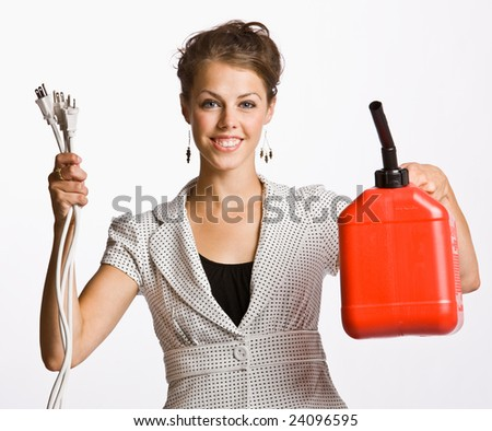 Businesswoman holding electrical plugs and gas can - stock photo