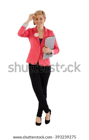 Businesswoman holding folder, standing over white background, smiling, looking away.