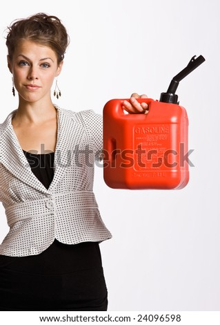 Businesswoman holding gas can - stock photo