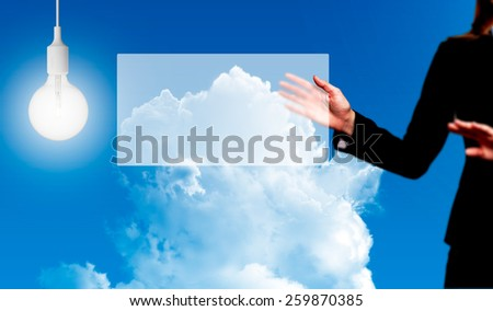 Businesswoman holding glass concept on a visual screen. The woman is dressed in a black suit. Stock Photo - stock photo