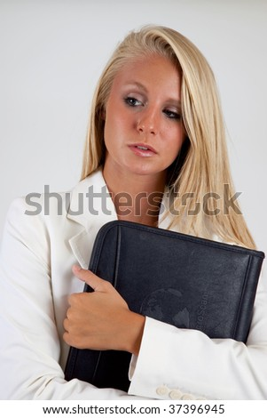 Businesswoman holding her notebook and thinking