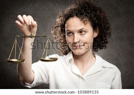 businesswoman holding justice scale - stock photo