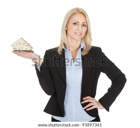 Businesswoman holding model of a house. Isolated on white - stock photo