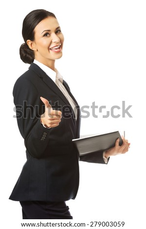 Businesswoman holding notes and showing thumb up. - stock photo