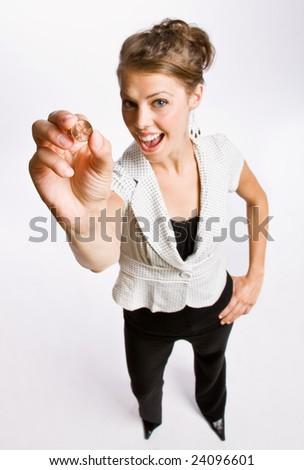 Businesswoman holding penny - stock photo