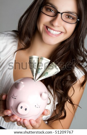 Businesswoman Holding Piggy Bank - stock photo