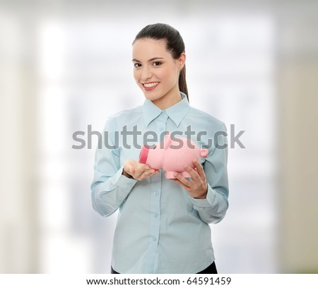 Businesswoman holding piggy bank. - stock photo