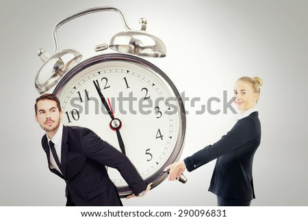 Businesswoman holding piggy bank against grey background