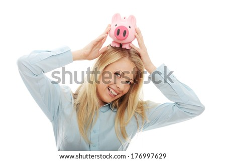 Businesswoman holding piggy bank. Isolated on white background  - stock photo