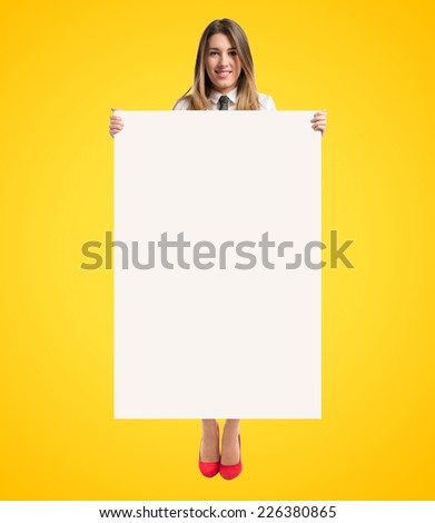 Businesswoman holding placard over yellow background