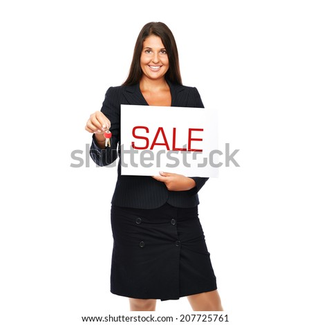 Businesswoman holding sale sign and keys.  Isolated on a white background.  - stock photo