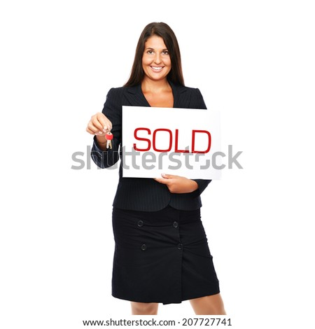 Businesswoman holding sold sign and keys. Isolated on a withe background.