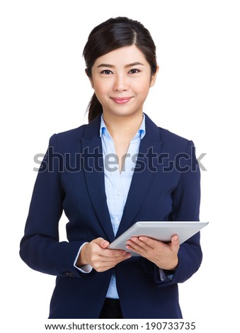 Businesswoman holding tablet computer - stock photo