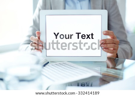 Businesswoman holding touchpad with your text - stock photo