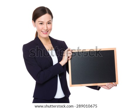 Businesswoman holding with chalkboard