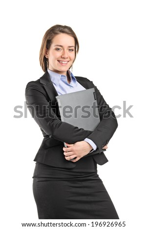 Businesswoman hugging a laptop isolated on white background - stock photo