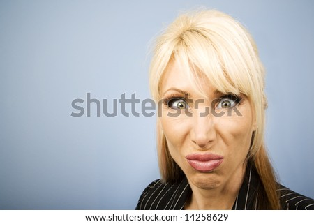 Businesswoman in a pinstripe suit making a funny face