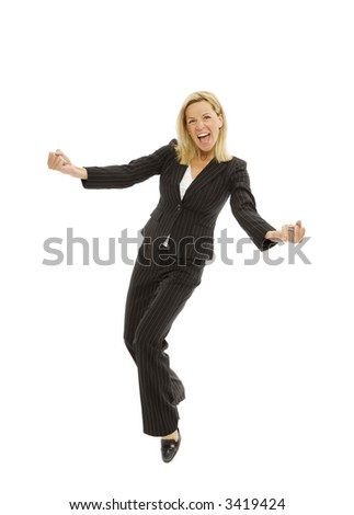 Businesswoman in a suit dances with excitement