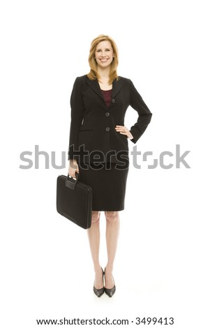 Businesswoman in a suit holds a briefcase - stock photo