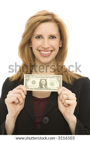 Businesswoman in a suit holds a dollar bill