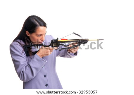 Businesswoman in a suit shooting an arrow from a crossbow as she aims at the target, isolated on a white background.