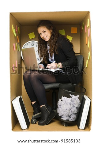 Businesswoman in a very small Cardboard Office isolated on white background - stock photo