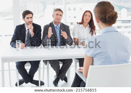 Businesswoman in a work interview with employers - stock photo