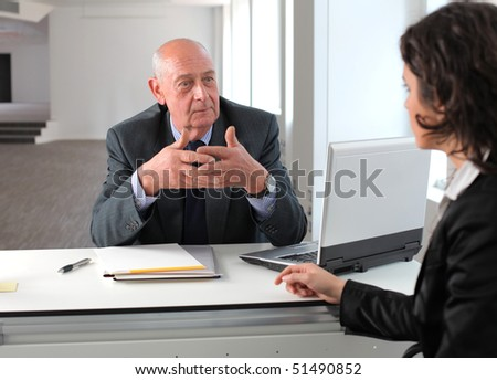 Businesswoman in an interview with a senior businessman - stock photo