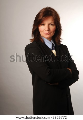 Businesswoman in black suit looking determined and sharp - stock photo