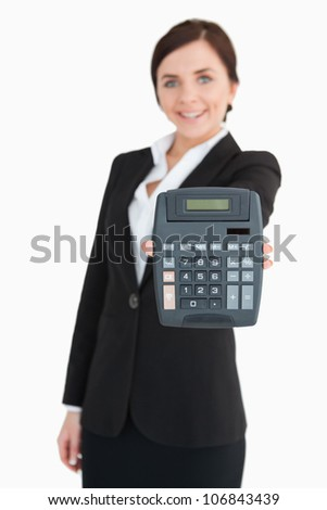 Businesswoman in black suit showing a calculator against white background