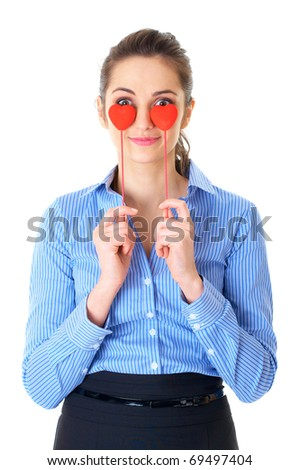 businesswoman in blue shirt holds two small hearts, hide her eyes behind them, isolated on white - stock photo