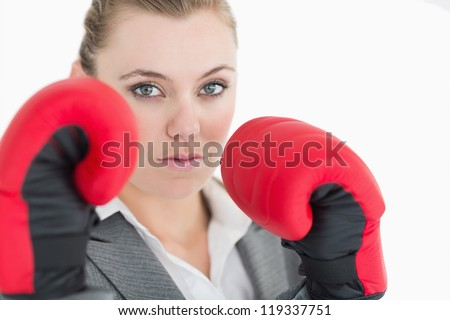 Businesswoman in boxing gloves ready to fight