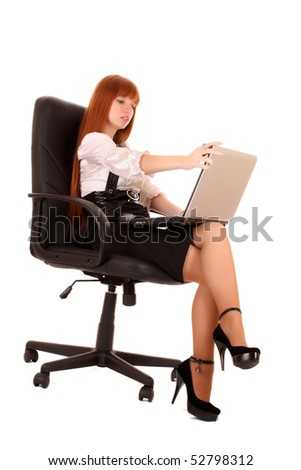 businesswoman in chair with laptop    on white background - stock photo