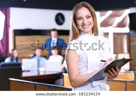 Businesswoman in conference room - stock photo