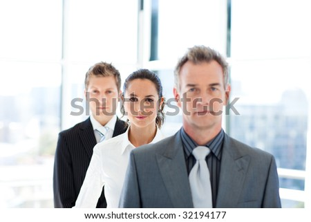 Businesswoman in focus in a line with her team