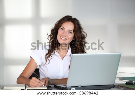 Businesswoman in front of computer in the office - stock photo