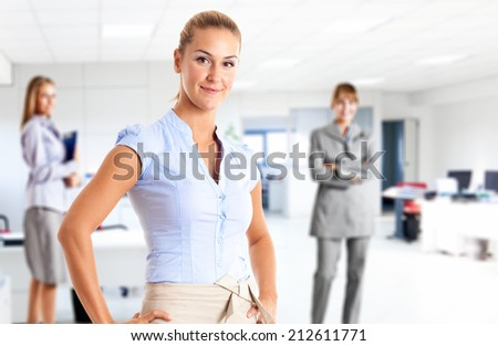 Businesswoman in front of her team - stock photo