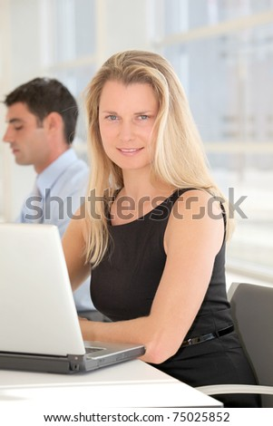 Businesswoman in front of laptop computer