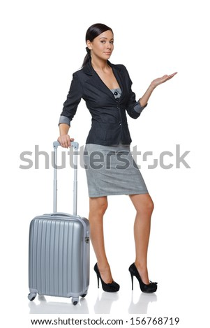 Businesswoman in full length with suitcase showing blank copy space / open hand palm, over white background - stock photo