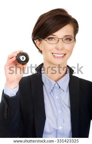 Businesswoman in glasses holding eight billiard ball. - stock photo