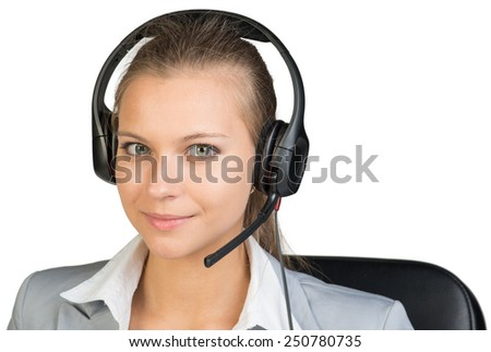 Businesswoman in headset looking at camera. Isolated over white background