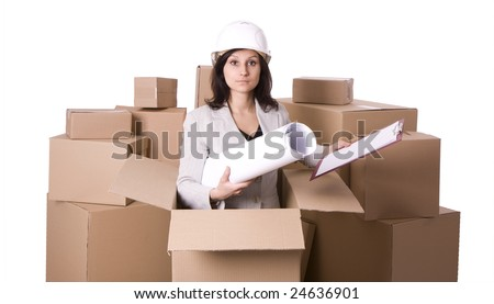 businesswoman in helmet with blueprint standing inside the carton box